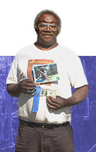 Mr. Williams holds the picture of him that won First Place in the South Carolina Rural Health Association Annual Photo Contest.